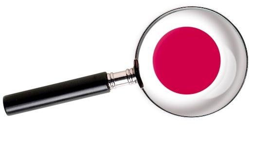 Förstoringsglas som zoomar in en röd cirkel