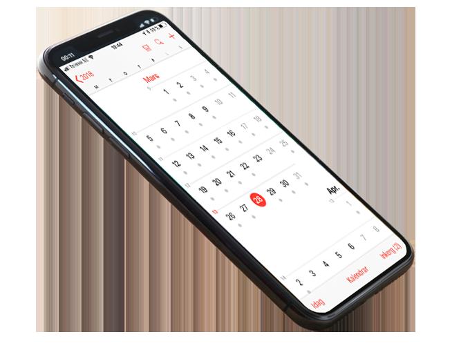 En mobiltelefon med kalender öppen på skärmen